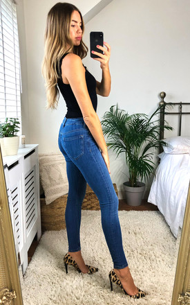 DGT HIGH WAIST SKINNY Mid Wash JEANS in Blue by Damn Good Thing