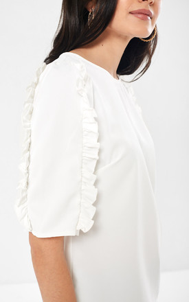 Frill Sleeve Blouse in White by Marc Angelo