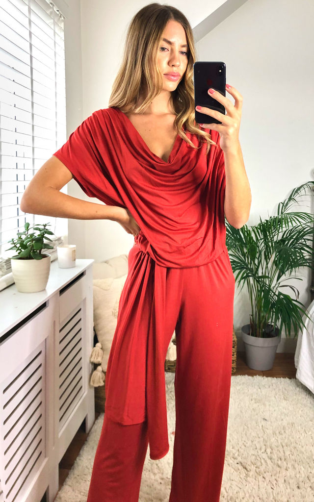 DEE LOUNGEWEAR JUMPSUIT WITH TIE WAIST IN RUST by EDDI CLOTHING