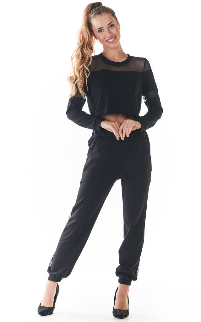 Joggers with Mesh in Black by AWAMA
