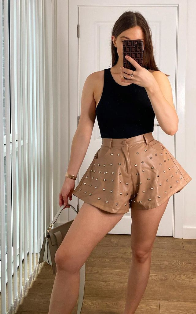 Ari Flared Faux Leather Shorts in Camel by IKRUSH