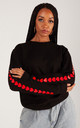 Black Sweatshirt with Red Heart Sleeves by Lime Blonde