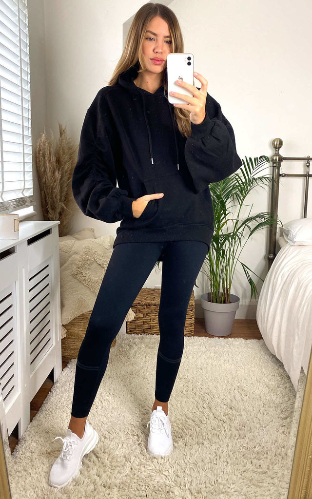 Ruched Sleeves Sweat Hoodie in Black by Gini London