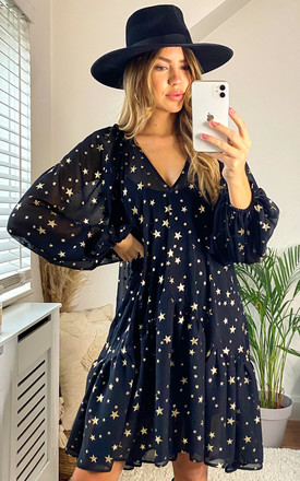 Poppy Star print smock dress in black with metallic stars by Edie b.