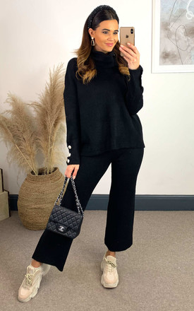 Black Knitted High Neck Jumper With Jewel Cuff And Knitted Straight Leg Trousers by The ModestMe Collection