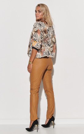 V-Neck Top with Decorative Strap in Floral Print by Makadamia