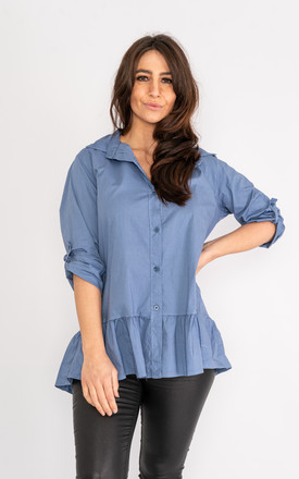 Blue button up collared blouse with buttoned rolled up sleeves. by Lucy Sparks