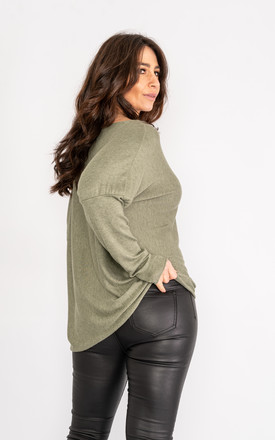 Khaki long sleeve jumper with sparkle embossed design. by Lucy Sparks
