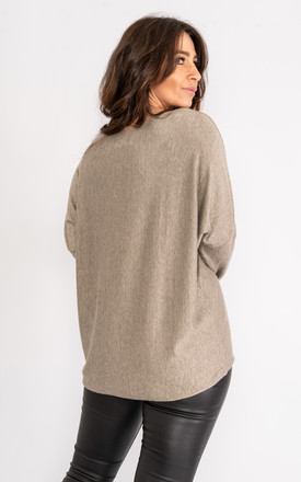 Taupe long sleeve jumper with sparkle embossed design. by Lucy Sparks