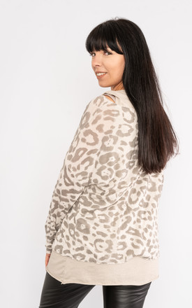 Beige long sleeve leopard print top with matching vest. by Lucy Sparks