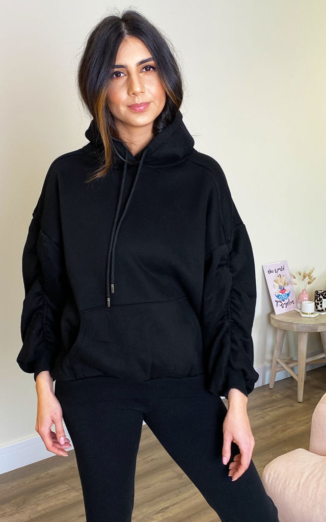 Ruche Sleeve Oversized Hoodie in Black by One Nation Clothing