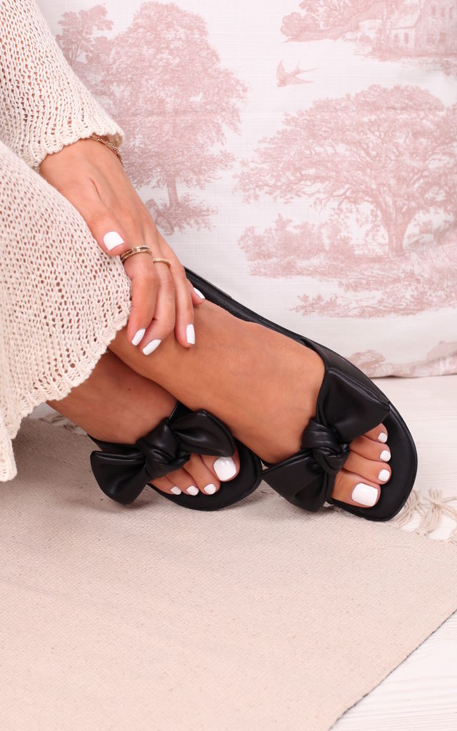 Honest Black Faux Leather Bow Flat Slider by Linzi